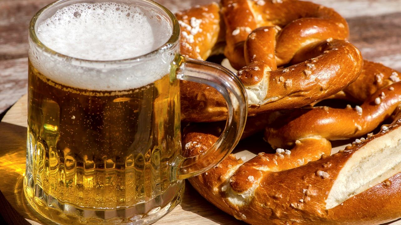 Mug of beer with plate of salted soft pretzels