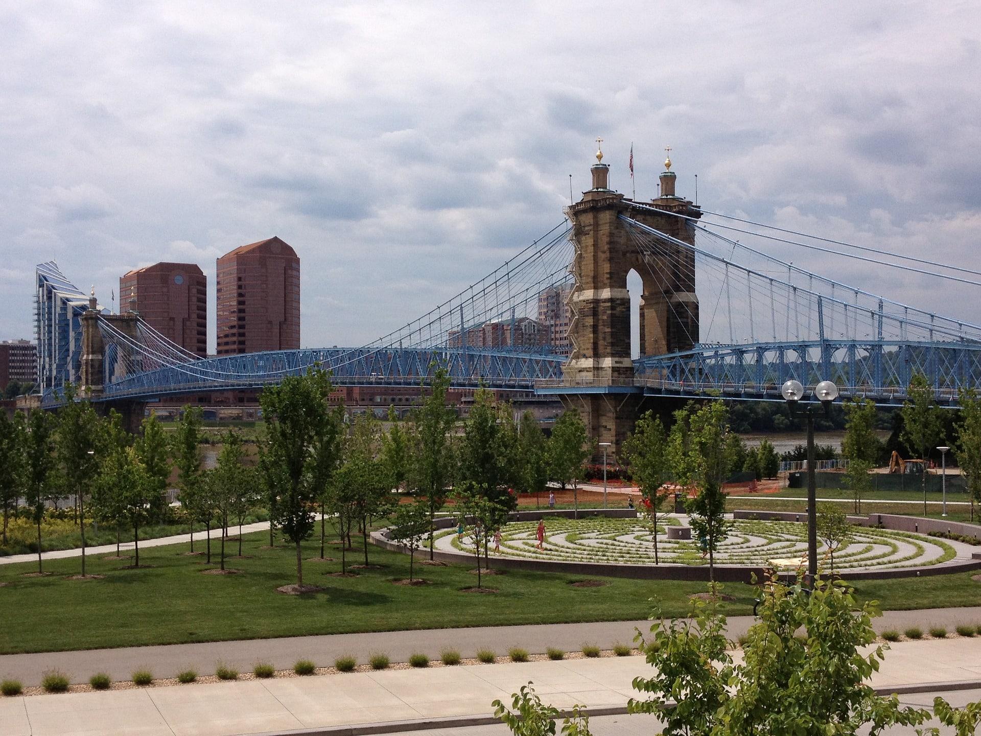Blue suspension bridge spanning park