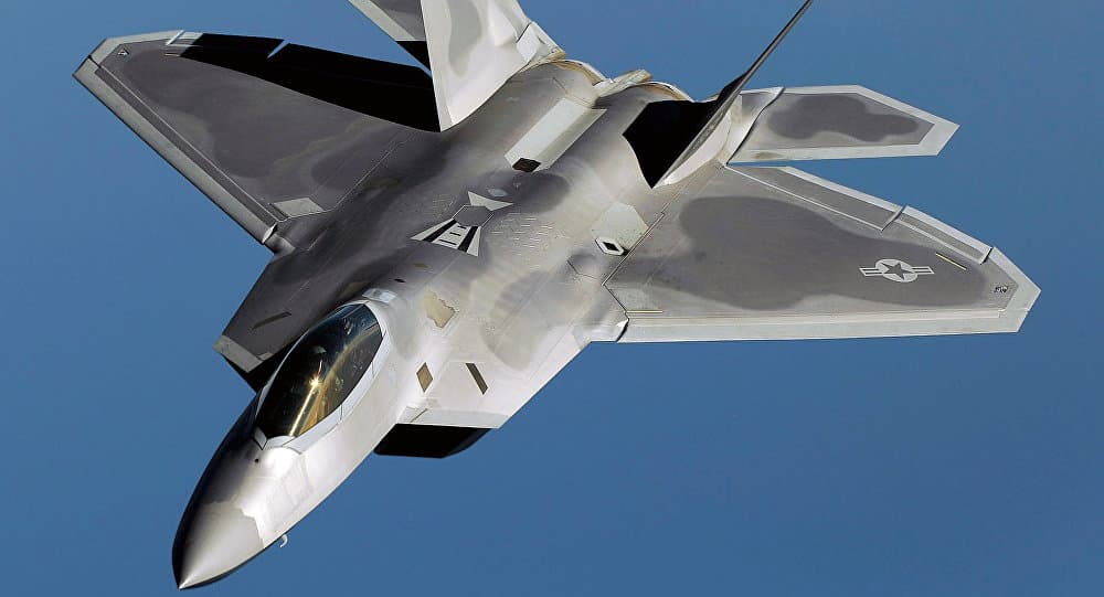 Silver F-22 Raptor Military plane flying in blue skies