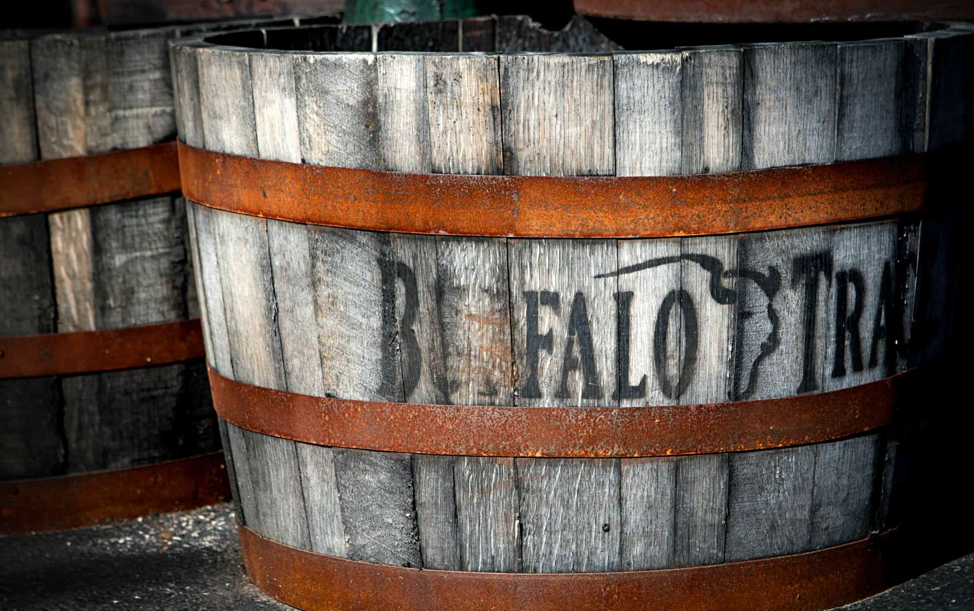 Old gray weathered bourbon barrel with the name Buffalo Trace stenciled on the front