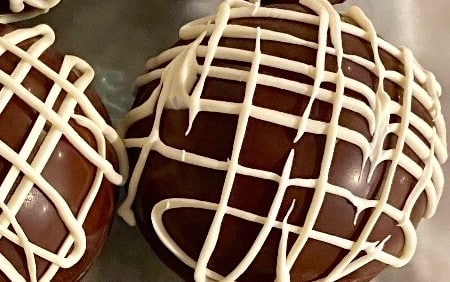 Round spheres of chocolate with white icing