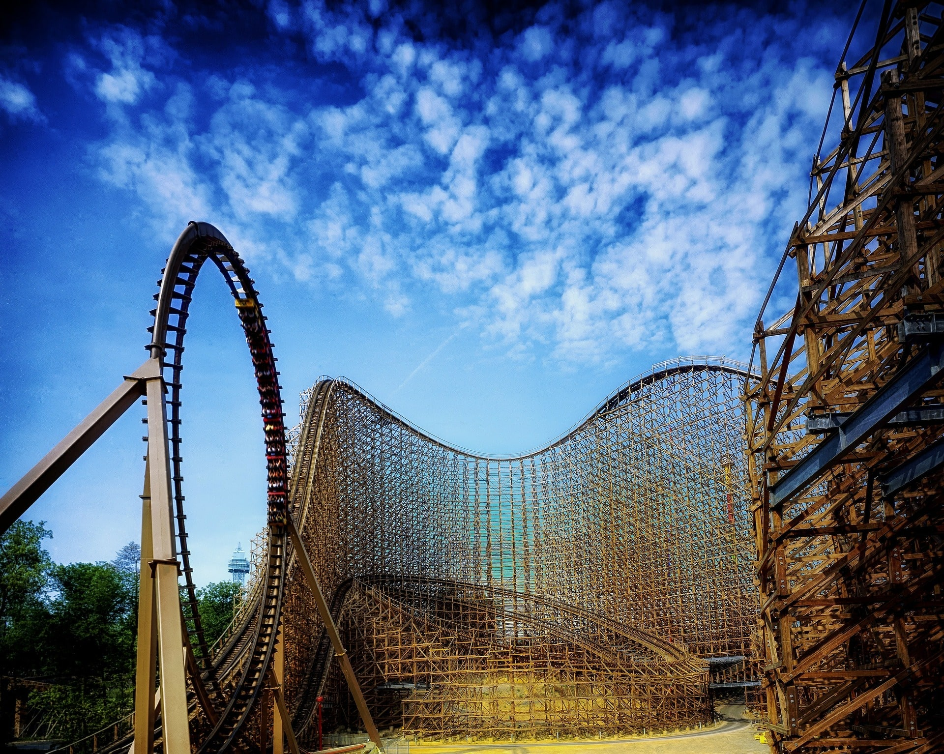 Wooden roller coaster in front of blue sky