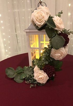White lantern with white and burgundy roses