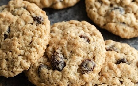 two golden brown cookies with raisins