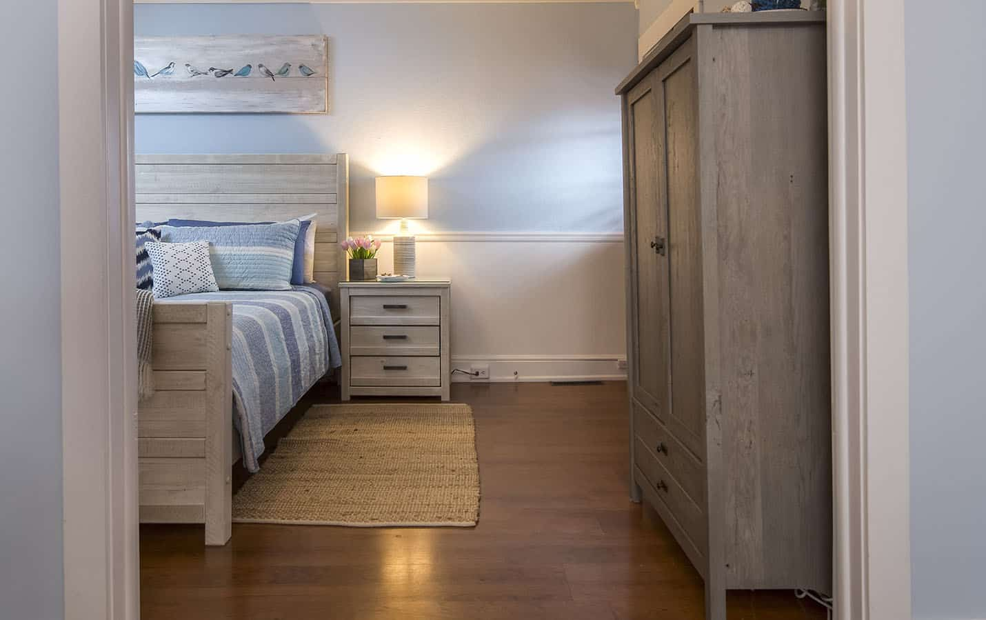Side of the bed with 3 drawer night stand and freestanding closet
