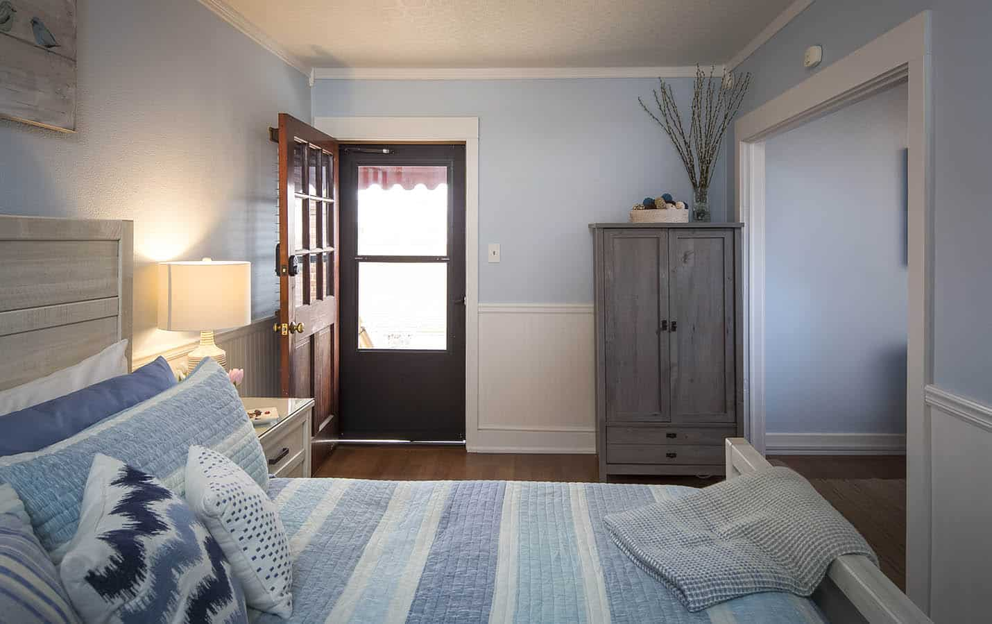 Entry view with layout of the room with bed and freestanding closet