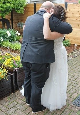 Man and woman embracing in a garden