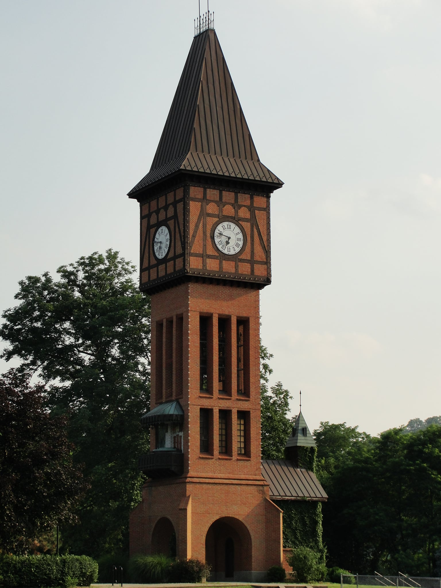Tall red brick clock tower