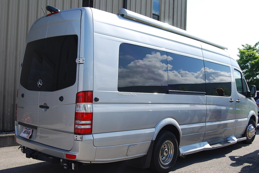 Silver van with dark tinted windows